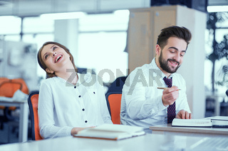A couple of colleagues at the desk
