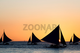 Sailing boats at sunset