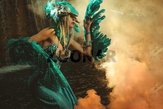 Fantasy scene, Beautiful blonde woman in fancy dress and blue angel wings on arms