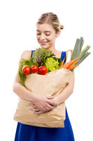 Beautiful woman carrying vegetables
