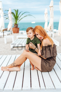 Mom and her little son on the beach, on vacation
