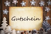 Old Paper With Christmas Decoration, Gutschein Means Voucher