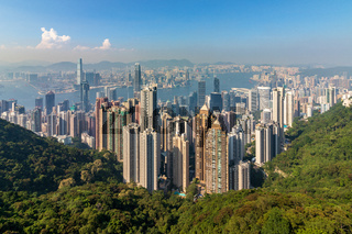 Panorama of Skyscrapers, Victoria Harbour and Hong Kong Bay. Taken from Victoria Peak Park on Hongkong Island. Hong Kong, China