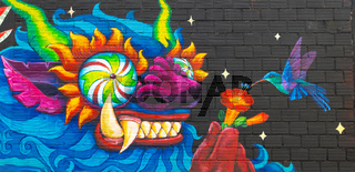 Bolivia La Paz mural representing a dragon and a colibri