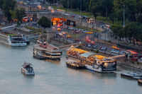 Aerial view Budapest along Danube with several moored party ships