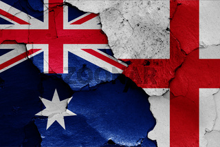 flags of Australia and England painted on cracked wall
