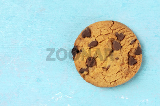 Chocolate chip cookie, gluten free, overhead shot on a blue background with a place for text