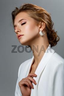 beautiful dark blonde girl in white jacket