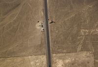Aerial airplane panoramic view to Nazca geoglyph lines aka lizard, hands and tree, Ica, Peru