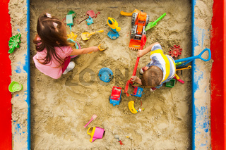 Top view of kids games in the sandbox