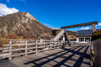 Mountain valley with stream and wooden bridge, Livingo, Italy, Alps