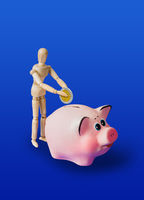 Wooden toy figure with coin and piggy bank on blue