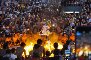 BALI, INDONESIA, January 2018, People watch  performance of Hanuman burning down Ravan's Lanka, in the form of Chak Chak dance at the Uluwatu temple.
