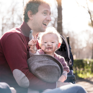 Father with cheerful child in the park.