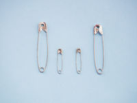 Several safety pins representing an unconventional family of gay, lesbian or transgender