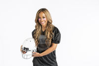 Beautiful African American Model Wearing A Football Helmet And Holding A Football