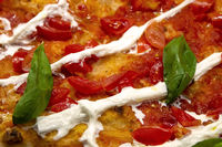 Pizza with tomatoes, cheese and basil