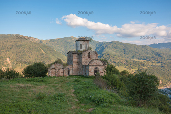 Old church in mountains, in national park Dombai, Caucasus, Russia