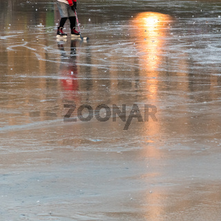 ice skater on a frozen pond with sunbeams