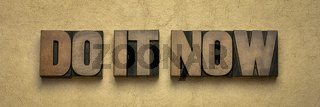 do it now - motivational word abstract in wood type