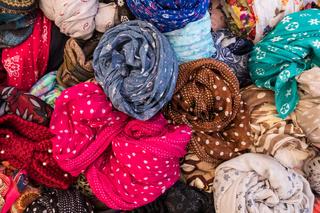 Woman colorful clothes sale.