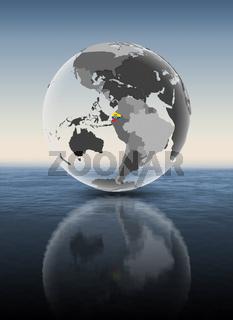 Ecuador on translucent globe above water