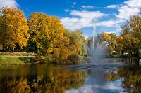 Valmiera. Latvia. City autumn landscape with a pond and fountain.