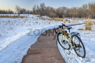 bicycle on windy trail in winter scenery