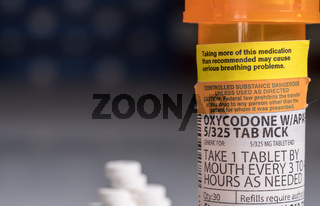 Macro of oxycodone opioid tablet bottle