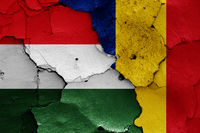 flags of Hungary and Romania painted on cracked wall