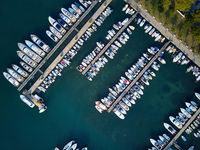 Top view at sea bay with pier and many boats and yachts