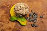 Healthy pumpkin muffins, vegan baked food, autumn dessert on wood background