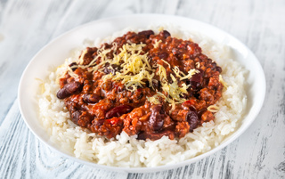Chili con carne served with white rice