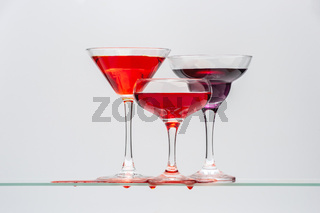 Three glasses with different drinks.
