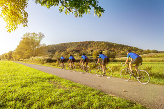 Multiple image of man on a racing bike in scenic autumn landscape