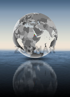 Eritrea on translucent globe above water