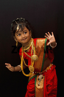 Little Indian girl posing in a traditional attire.