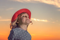 Cute girl with red hat portrait at dusk