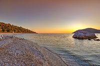 The sunset at the beach Milia of Skopelos, Greece