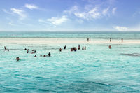 Red sea white sandy island. Egypt, Snorkel tourist snorkeling with mask.