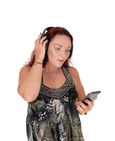 Woman listening to music from her cell phone