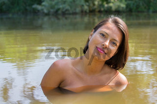 Portrait pretty woman in natural water