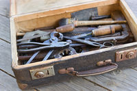 A suitcase with old hand tools