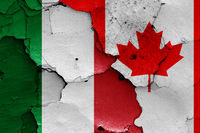 flags of Italy and Canada painted on cracked wall