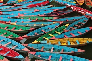 Multi colored rowing boats on Fewa lake, Pokhara.