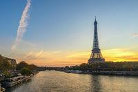 Paris France city skyline sunrise at Eiffel Tower and Seine River