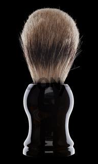 Close up of shaving brush on black