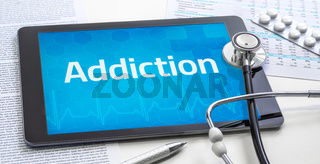 The word Addiction on the display of a tablet