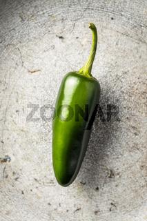 Green jalapeno pepper.