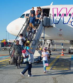 Passengers people leave airplane airport
